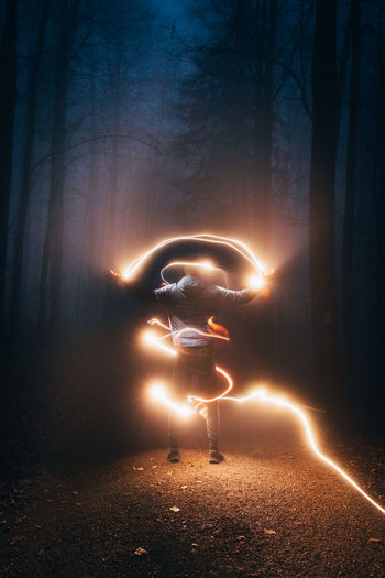 Digital composite image of light painting at night