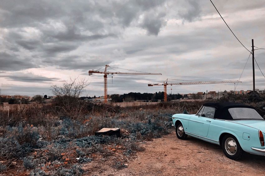 IPhone Photography Iphonephotography IPhone Iphoneonly IPhoneography Nature Outdoors No People Land Vehicle Electricity Pylon Cable Sky Cloud - Sky Transportation Car Landscape Landscape_Collection Vintage Cars Cloud And Sky Mood