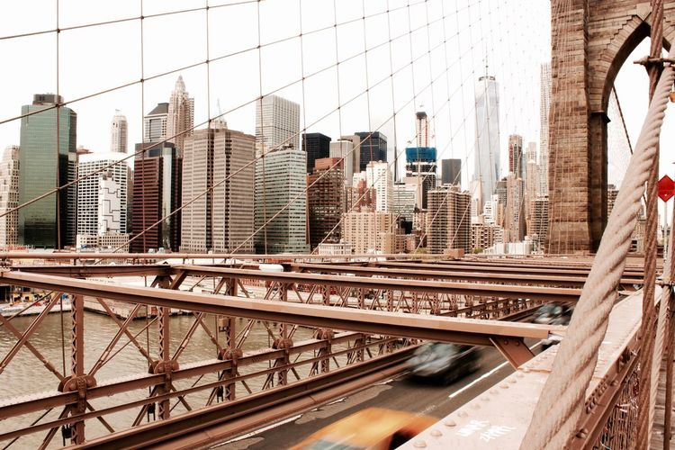 Brooklyn bridge against cityscape