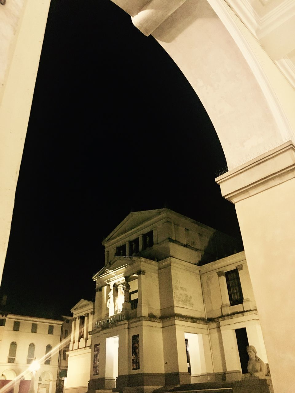 architecture, built structure, building exterior, low angle view, history, architectural column, no people, night, illuminated, dome, outdoors, sky