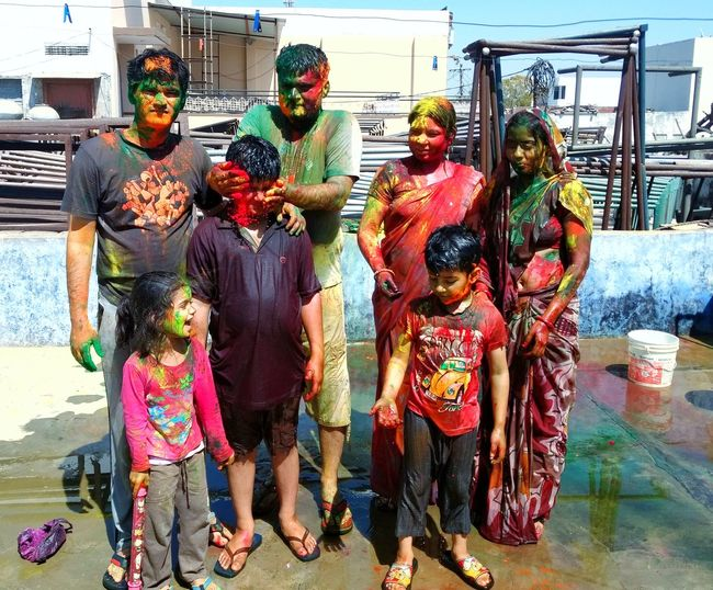 the festival of colours Festval Day Playing Holi With Colors People Together Playing Holi And Saying Happy Holi...