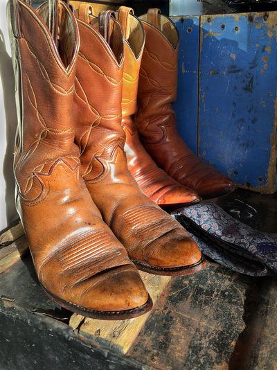 Cowboy boots at vintage clothing shop in Denver CO American Boots Close-up Colorado Cowboy Cowboy Boots Culture Day Denver Denver,CO Display Leather Old Rundown Shoe Shoes Shop Still Life United United States United States Of America Vintage