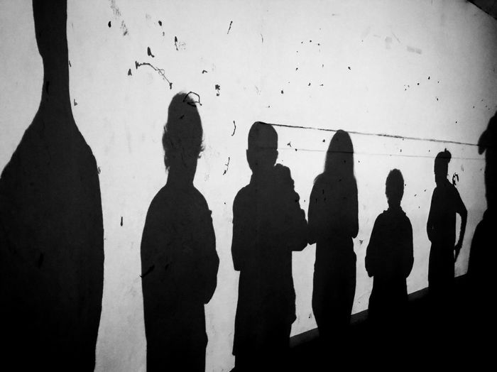 Shadow of children on wall