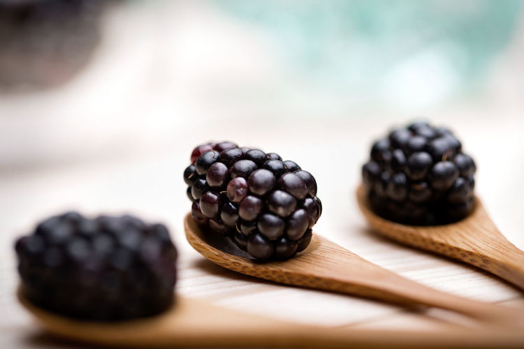 Close-up of blackberries on cutting board