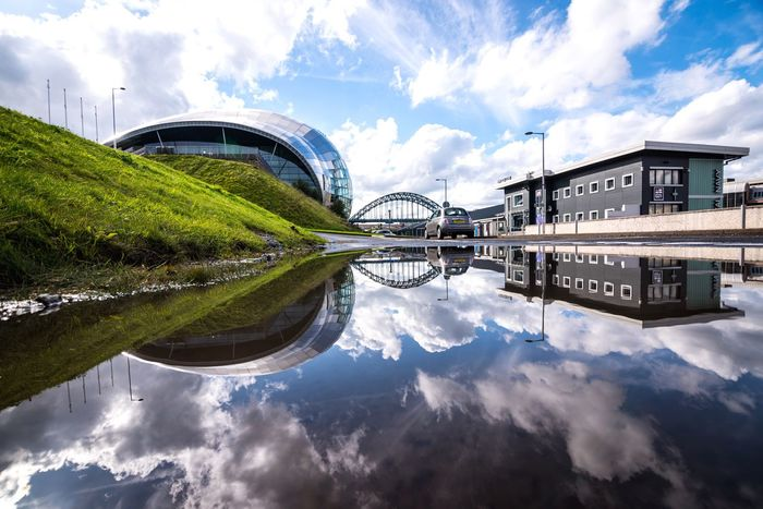 Newcastle in a puddle Cloud - Sky Architecture Sky Reflection Water Building Exterior Built Structure Waterfront River Bridge - Man Made Structure City Modern Outdoors No People Day Nature Cityscape Newcastle Nikonphotography Nikon EyeEm Best Shots EyeEm Gallery EyeEm Tyne Bridge The Sage