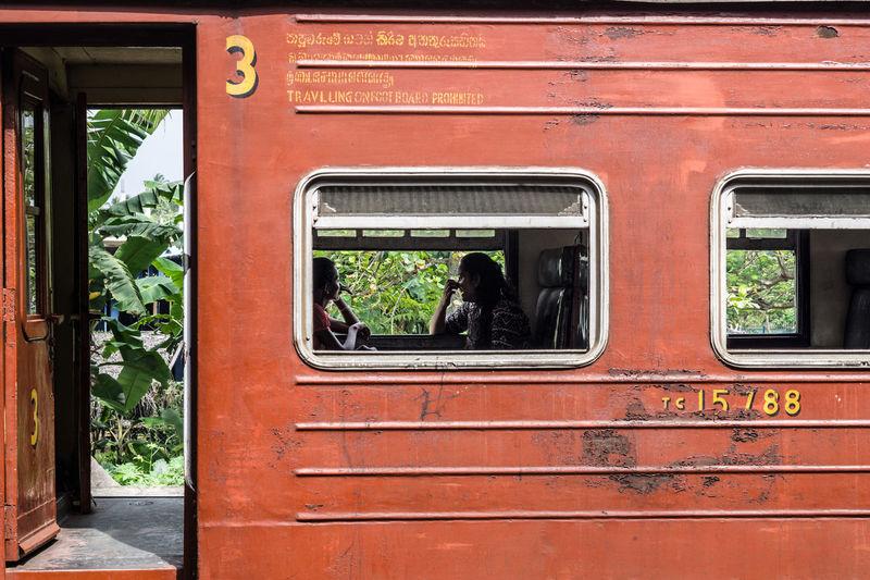 Women sitting by window in train