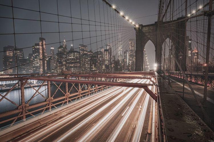 Bridge in city at night