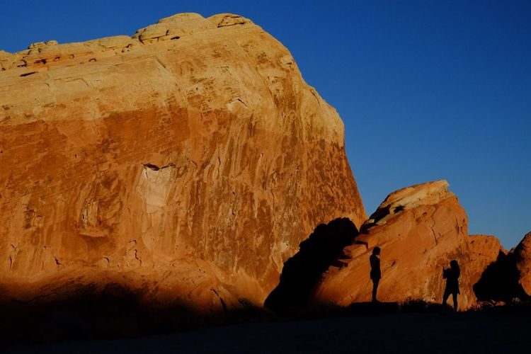 Posing Rock - Object Silhouette Outdoors Travel Destinations Landscape No People Beauty In Nature Nature Clear Sky Day Sky Sunset Desert Women Valley Of Fire State Park Nevada Desert Modern Growth Streetphotography Beauty In Nature Sunlight Sunny Friendship Young Women Females