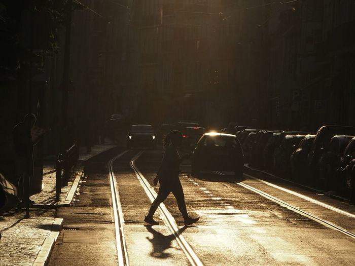 Side View Of Woman Crossing Street