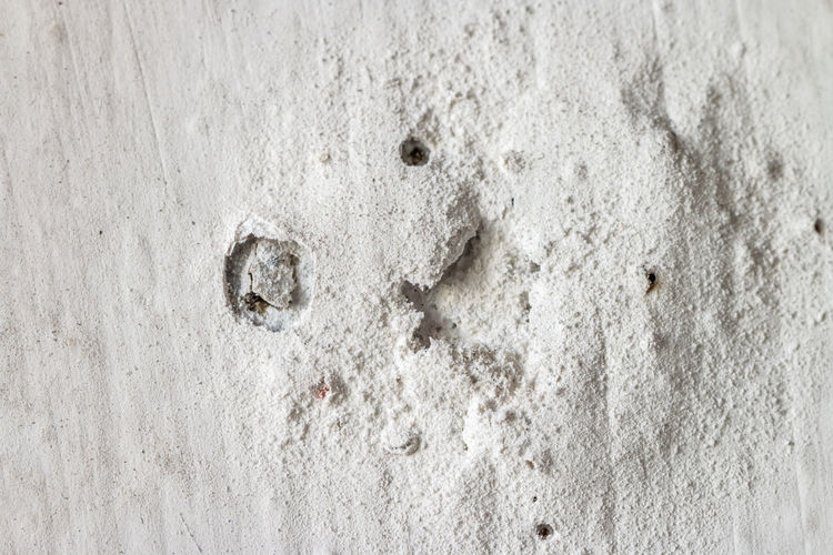 Texture of concrete wall with old paint peeling off. Macro. Bad Condition Decay Backgrounds Built Structure Chipping Paint Close-up Concrete Concrete Wall Background Cracked No People Old Paint Peeling Off Pattern Peel Peeling Off Rough Textured  Wall Wall - Building Feature White Color