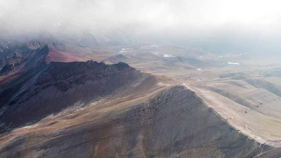 Aerial Aerial View DJI X Eyeem Mountain Range South America Peru Fog Mountain Planet Earth Snow Fog Sky Landscape Cloud - Sky Hiker Geology Rugged Arid Climate This Is Latin America