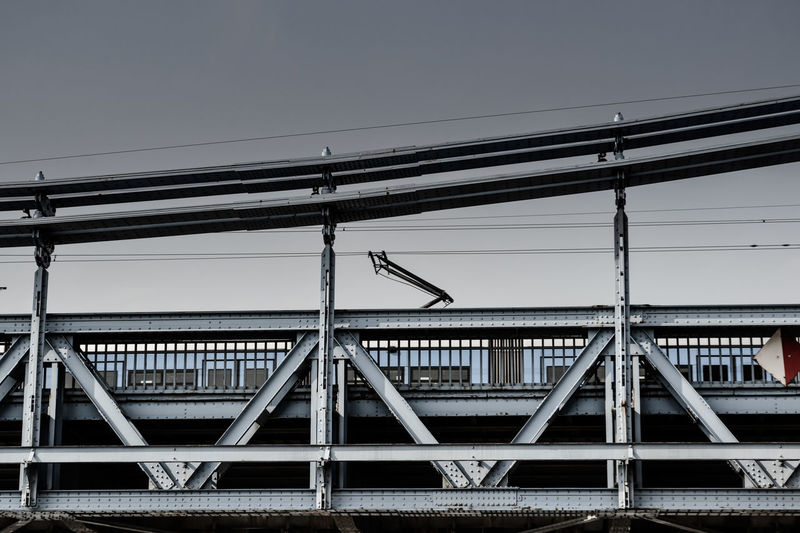 Low angle view of train on railway bridge against clear sky