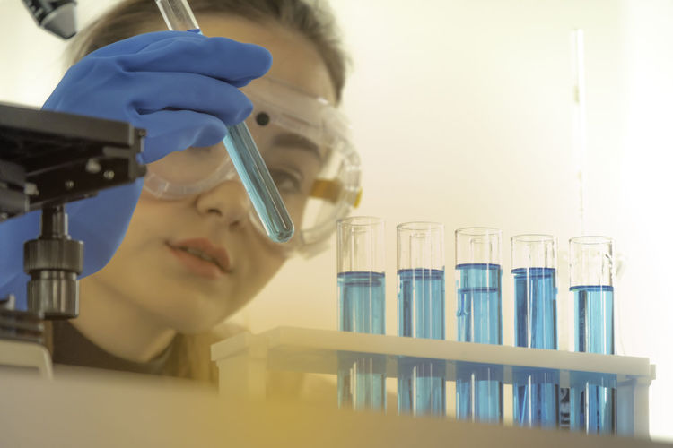 Close-Up Of Scientist Performing Experiment At Laboratory