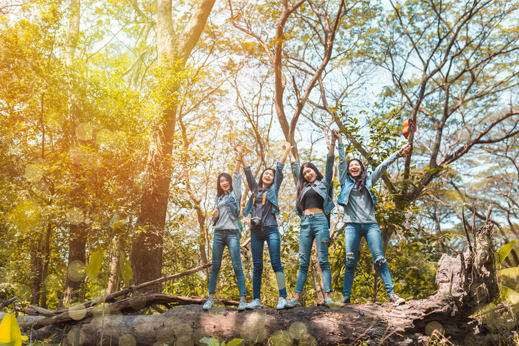Group of Asian women destination finish enjoy and happy travel trekking in vacation time for go to camping. Tree Togetherness Group Of People Men Standing Adult Full Length Women Nature Young Adult Day Casual Clothing Autumn Males  Smiling Young Men Plant Happiness Forest Outdoors Change