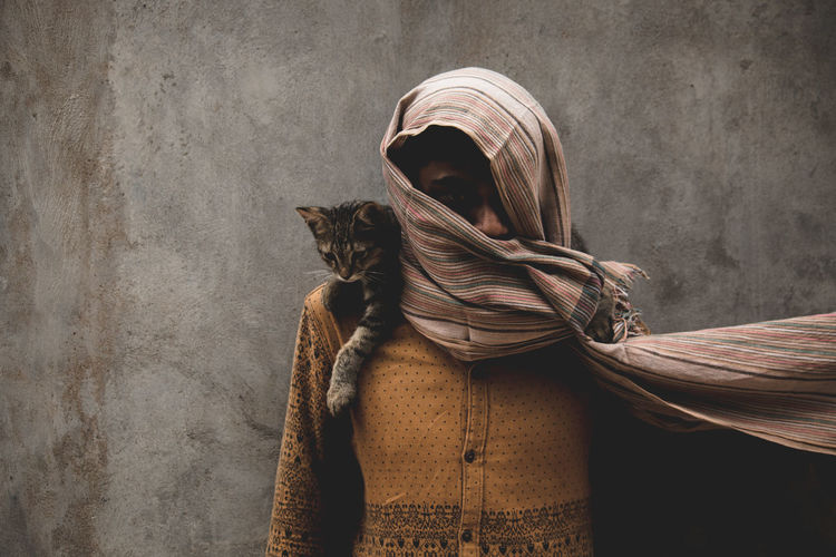 Man Portraits Tradition Traditional Clothing Animal Animal Head  Animal Themes Bonding Cat Day Domestic Domestic Animals Domestic Cat Feline Headshot Pets Portrait Relaxation Rope Textile Towel Trust Wall - Building Feature Whisker