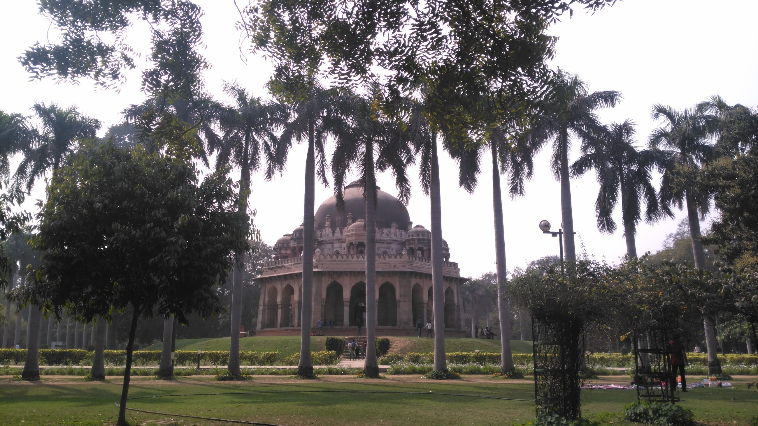 tree, architecture, built structure, building exterior, famous place, religion, grass, clear sky, history, travel destinations, place of worship, tourism, spirituality, travel, lawn, sky, international landmark, dome, low angle view, facade