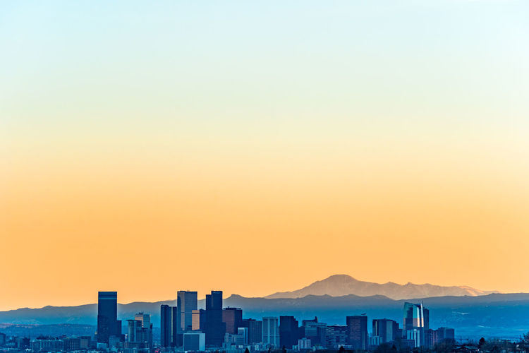 Denver Skyline against a background of the Rocky Mountains Architecture Building Exterior Sky Built Structure City Sunset Cityscape Building Nature No People Outdoors Beauty In Nature Scenics - Nature Skyscraper Day Colorado Skyline Rocky Mountains Pikes Peak Denver Denver Colorado  Copy Space Clear Sky Mountain Urban Skyline Orange Color Landscape Mountain Range Office Building Exterior Romantic Sky