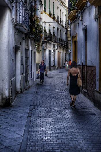 That Moment when a Single Man walks by a Single Attractive Woman ... You can Feel the Tention In The Air 😚 City Street Building Exterior People Day Adults Only Walking Architecture Real Life EyeEm Selects EyeEmNewHere