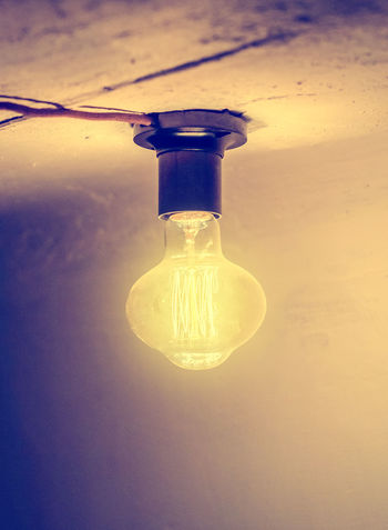Vintage lamp in the cartridge, it is illuminated with yellow light Lighting Equipment Light Bulb Close-up Transparent No People Indoors  Glass - Material Illuminated Electricity  Single Object Light Reflection Still Life Filament Glowing Focus On Foreground Orange Color Table Nature