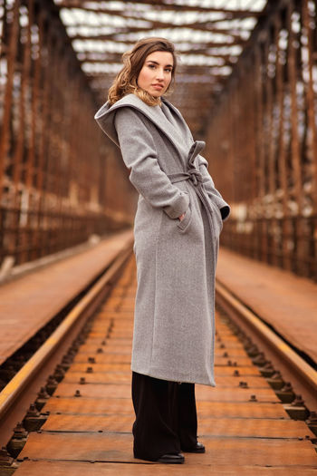 Full length of woman standing at railroad station