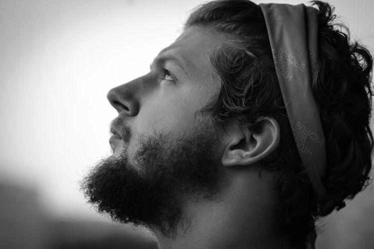 Close-up of thoughtful bearded man wearing bandana