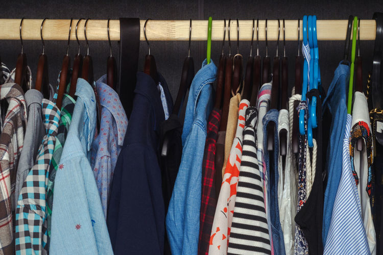 Men's and women's clothing on a hanger in the closet