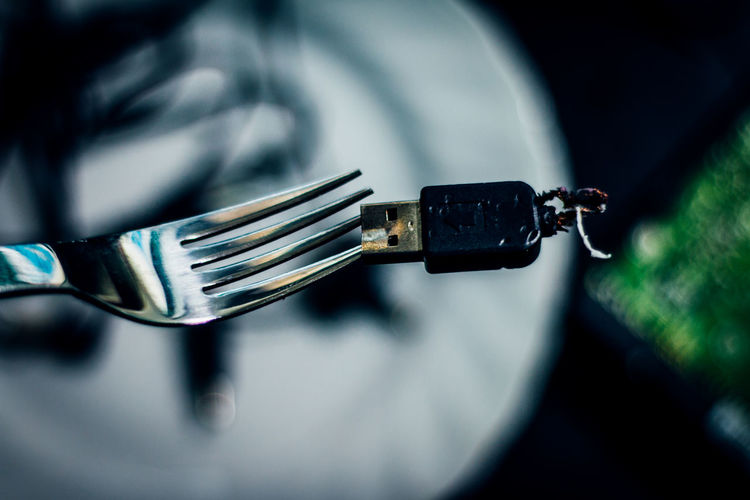 Close-up of usb stick on fork