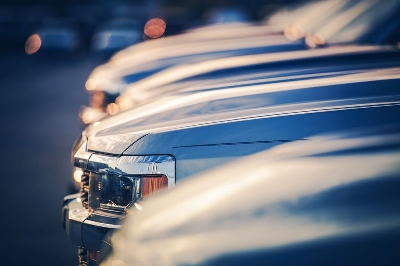 Close-up of cars parked during sunset