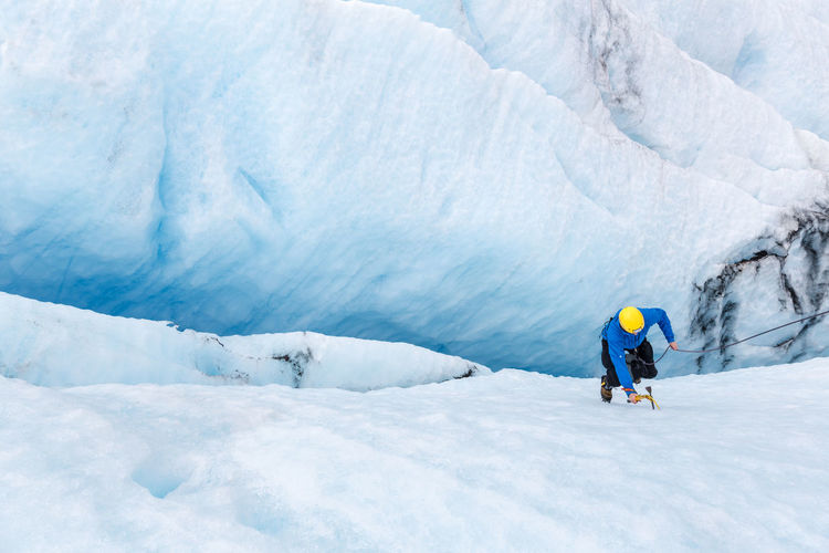 Exploring a crevasse on a glacier. Activity Adventure Ice Age Bird's Eye View Blue Blue Ice Climbing Covering Crevasse Glacier Hiking Ice Landscape Mountain Nature Non-urban Scene Northern Norway Remote Scenics Strupbreen Summer Unrecognizable Person Warm Clothing White White Color The Great Outdoors - 2017 EyeEm Awards Lost In The Landscape