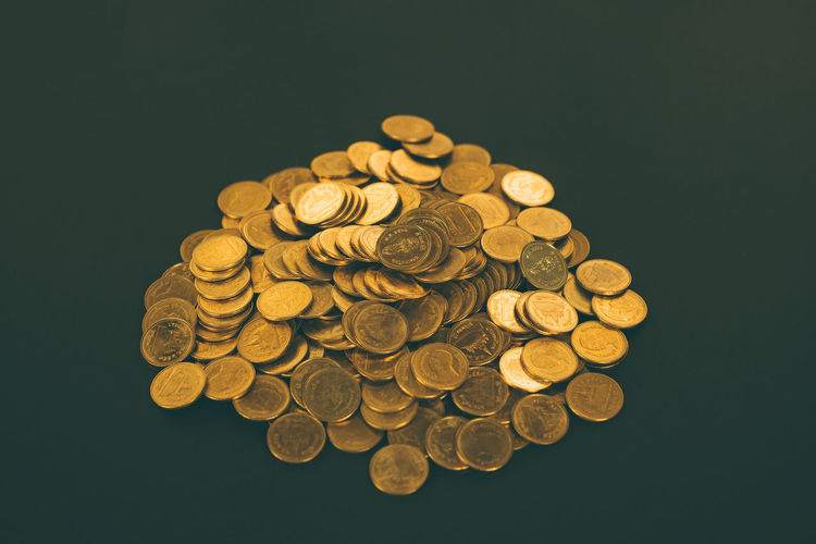High angle view of coins on black background