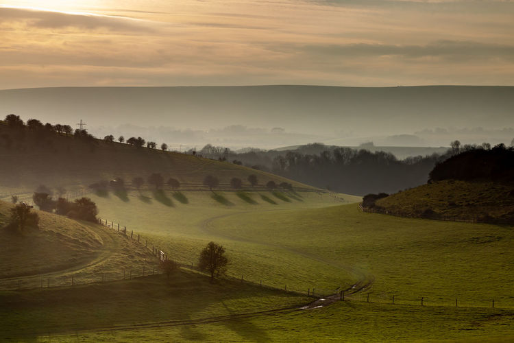 An idyllic south downs winter landscape with late afternoon light