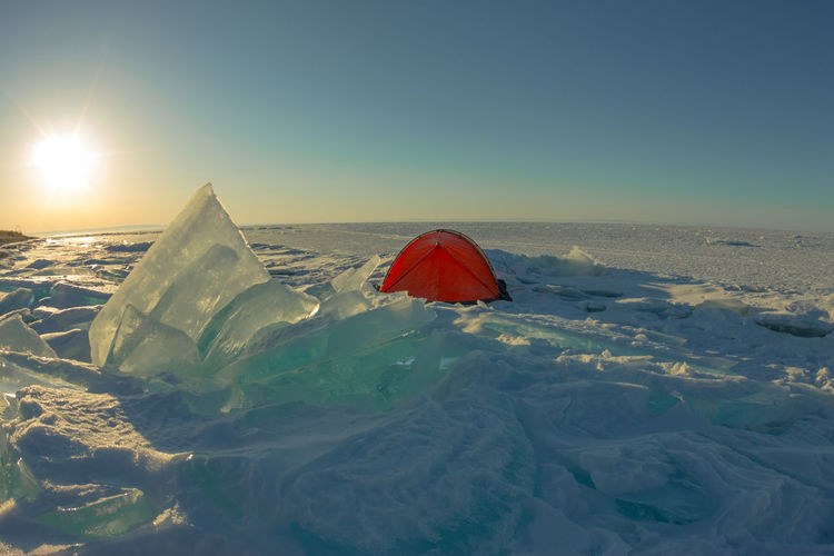 orange tent at dawn amid the blue ice of Baikal Be. Ready. Ice Baikal Bike Clear Sky Dawn Day Nature Outdoors Sky