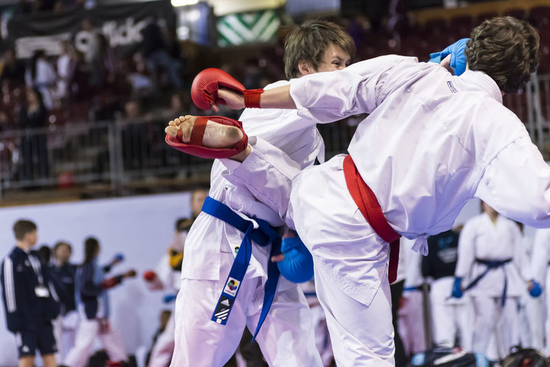 Karate Kumite in action Depth Of Field Exercise Extreme Sports Fight Fighter Fighting Fitness Karate Karate Kid Kumite Lifestyles Punching Real People Sports Photography Wkf Young Adult Young Men