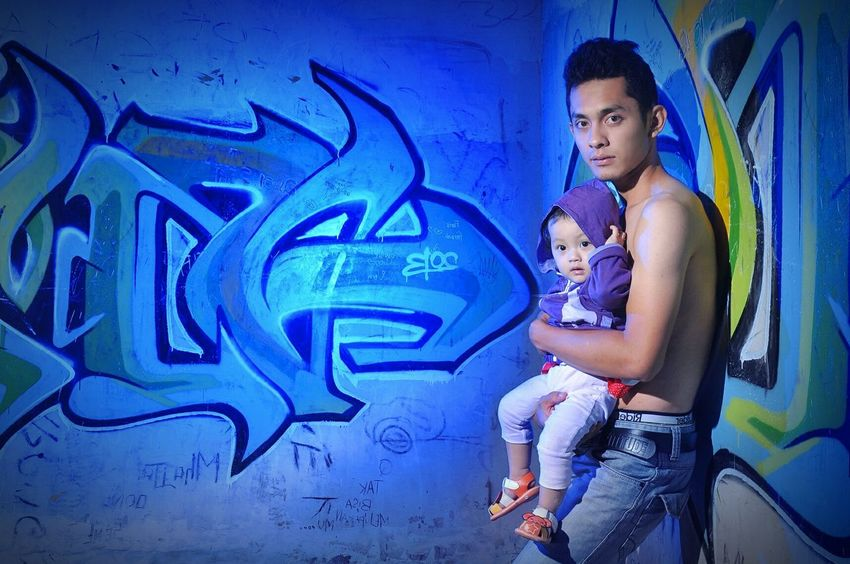 Family Portrait Graffiti Casual Clothing Young Adult Blue Sitting Lifestyles Young Women Wall - Building Feature Art Full Length Leisure Activity Creativity Person Man Fatherhood Moments Father And Daughter Father Father's Day Kid Colorgels Bluecolorsexplosion Bluecolors Strobist Sonnysanjaya