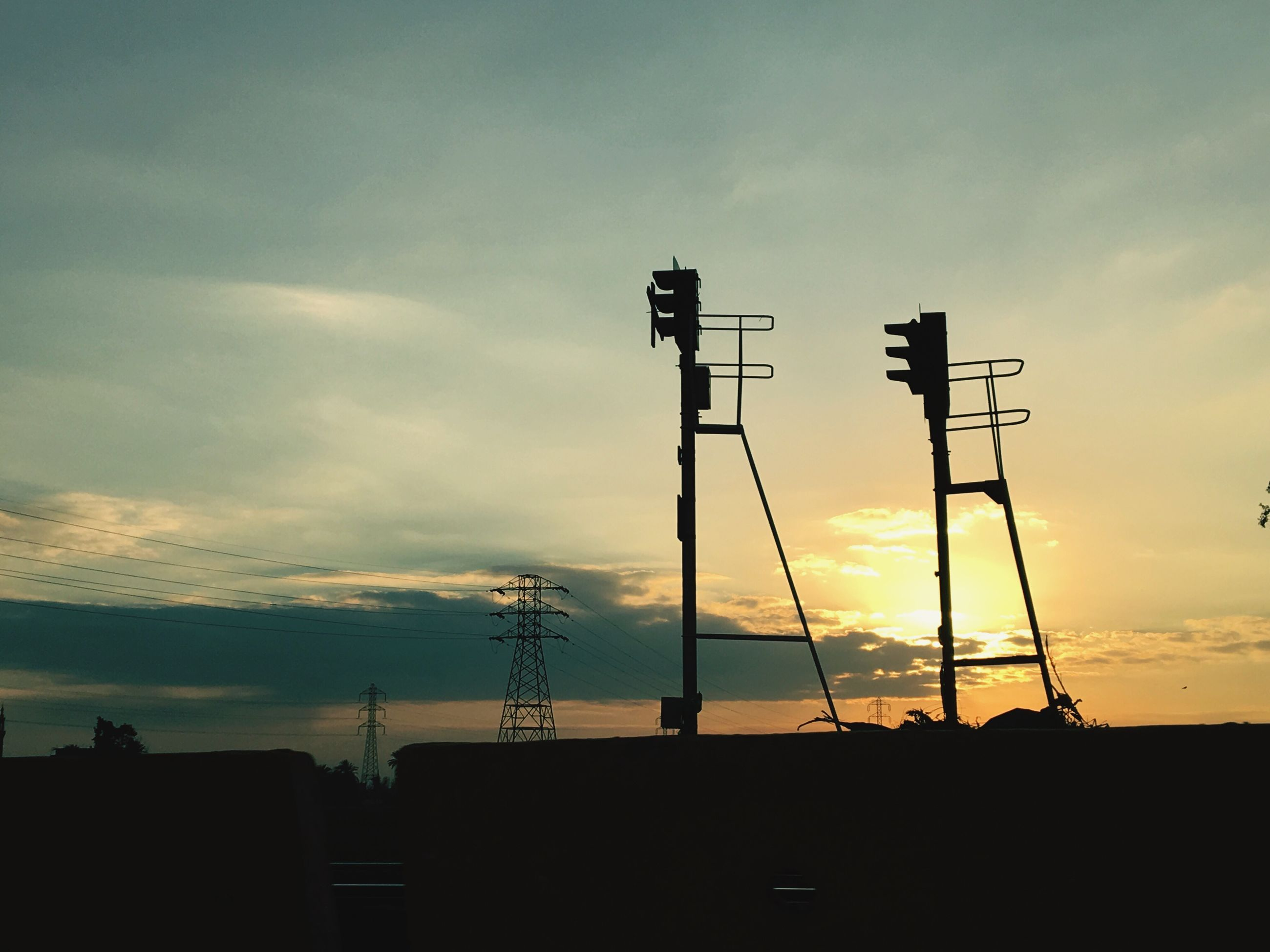 sunset, sky, silhouette, cloud - sky, low angle view, built structure, orange color, cloud, building exterior, architecture, cloudy, nature, beauty in nature, scenics, outdoors, no people, tranquility, technology, fuel and power generation, dusk