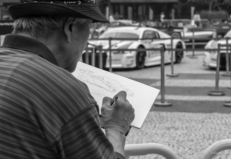 Man Drawing Car Sketch In City