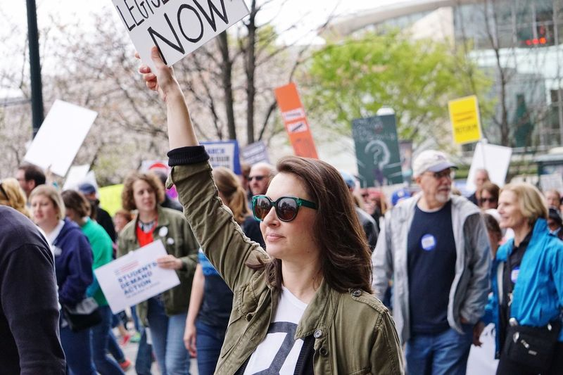Gun Control EyeEm Selects Protestor Politics Protest Crowd Young Adult Large Group Of People Banner - Sign Young Women Men Social Issues Event Arts Culture And Entertainment Riot Adults Only Real People People Adult Ticket Text Placard