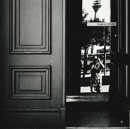 Open door Blackandwhite Black And White Blackandwhite Photography Black&white Full Length Men Doorway Leaving City Business Finance And Industry Door Window Entrance Architecture Open Door Entryway Front Door Doorknob Entry Door Handle Keyhole #urbanana: The Urban Playground