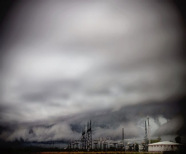 Pivotal Ideas Storm, Dark, Rain, Cloud, Awe, Overpowering power supply, power line, electricity, electrical , transformer, power sub station, Sky, nature, steel structure, steel bracing, metal, tower, house.