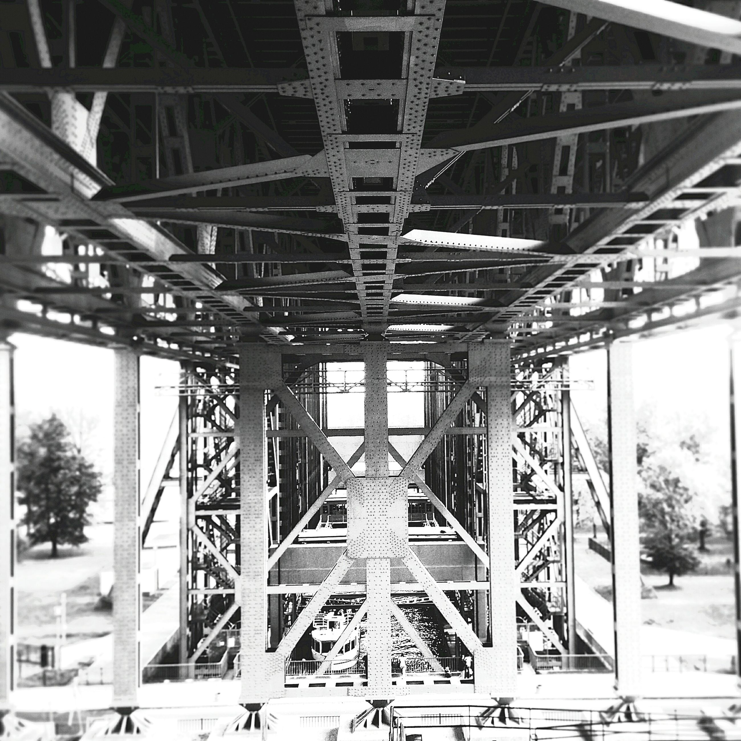 architecture, built structure, connection, bridge - man made structure, engineering, architectural column, bridge, support, low angle view, metal, arch, column, indoors, railing, day, no people, sky, metallic, long, sunlight