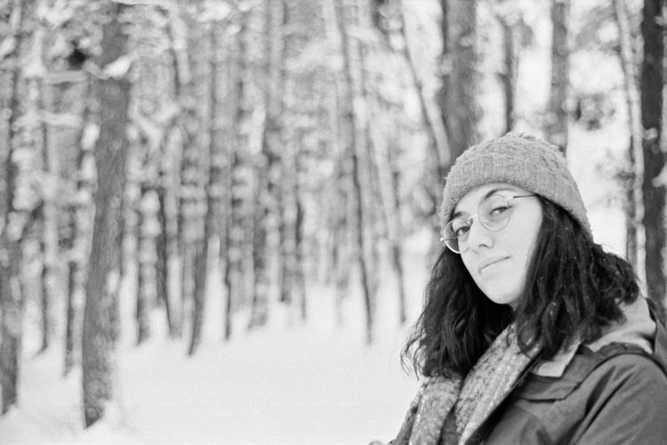 Portrait of woman in forest during winter