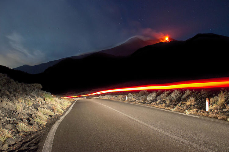 Eruption Road Mountain Transportation Sky Night The Way Forward No People Direction Beauty In Nature Speed Light Trail Long Exposure Sign Nature Illuminated Motion Scenics - Nature Non-urban Scene Mountain Range Street Outdoors Etna Eruption Summer Sicily