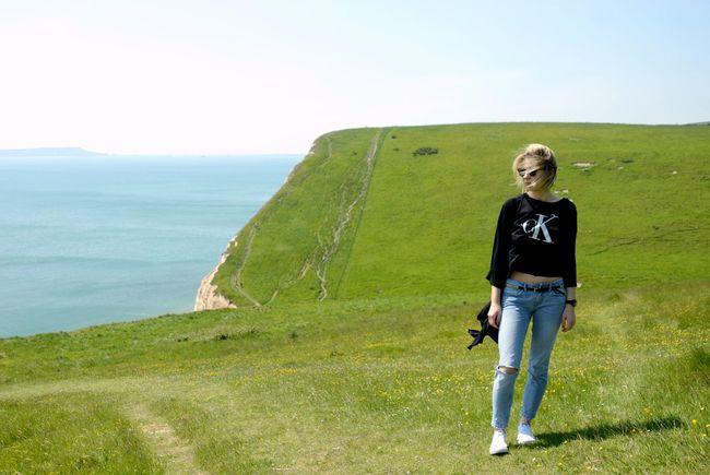 Durdle Door Dorset Green Grass Sea Sky View Calvin Klein Woman Shot Nikon Photography Somewhere In The Middle