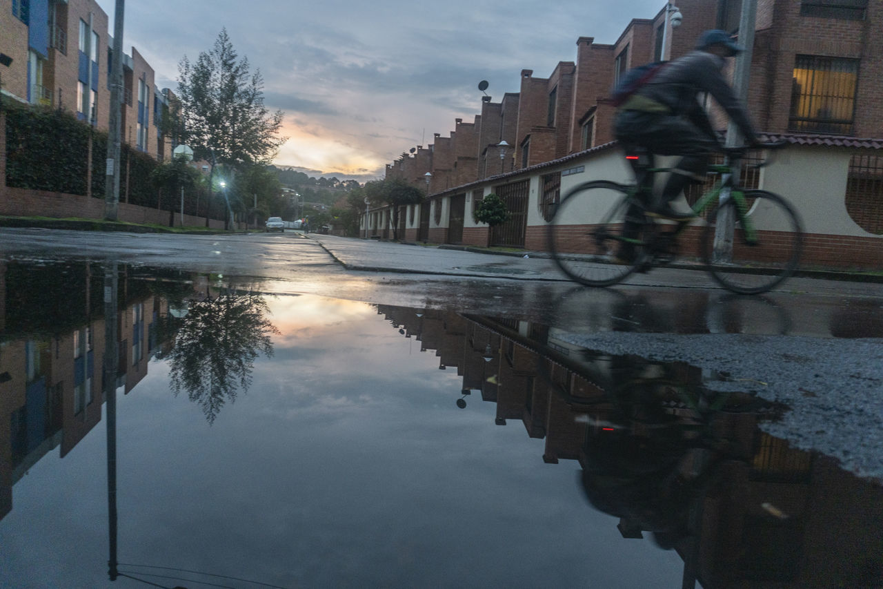 REFLECTION OF BUILDINGS ON PUDDLE IN CANAL