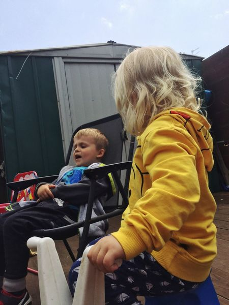 Two People Childhood Real People Blond Hair Boys Family Brother Leisure Activity Day Togetherness Warm Clothing Baby Stroller Outdoors Sky People