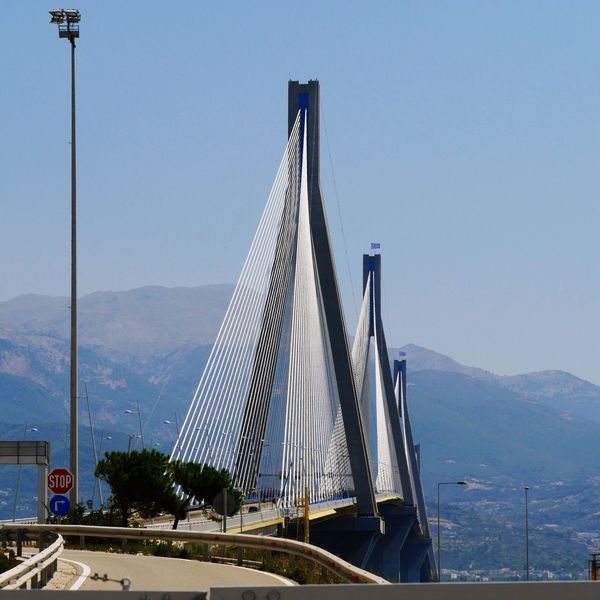 Your Ticket To Europe Patras Greece Peleponnes Transportation Architecture Built Structure Connection Bridge - Man Made Structure Mountain Day Suspension Bridge Outdoors Mode Of Transport No People Sky Travel Destinations Building Exterior Clear Sky City Nature