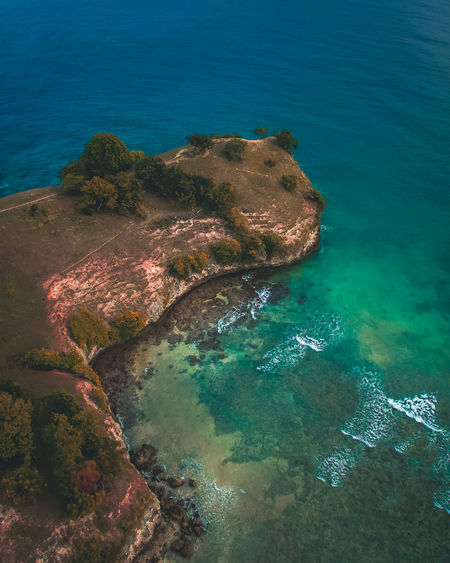 Watching from Here Sea Water High Angle View Beauty In Nature Nature Scenics - Nature Tranquility Tranquil Scene Land Rock No People Aerial View Day Beach Outdoors Rock - Object Blue Island Solid Turquoise Colored Marine