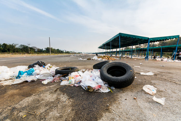 Abandoned tires and garbage at parking lot