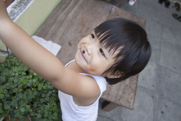 Close-up of cute boy playing in back yard