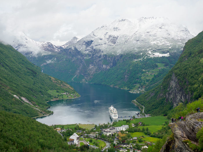 View over Geiranger Fjord and Valley Water Mountain Beauty In Nature Scenics - Nature Nature Day Sky No People Tranquil Scene Tranquility Environment Outdoors Fjord Cruise Ship Snowcapped Mountain